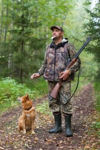 depositphotos_60050087-stock-photo-man-with-dog-out-hunting